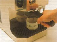 Place coffee cup under holder press brew button