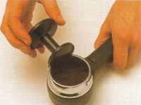 Tamp espresso coffee down firm